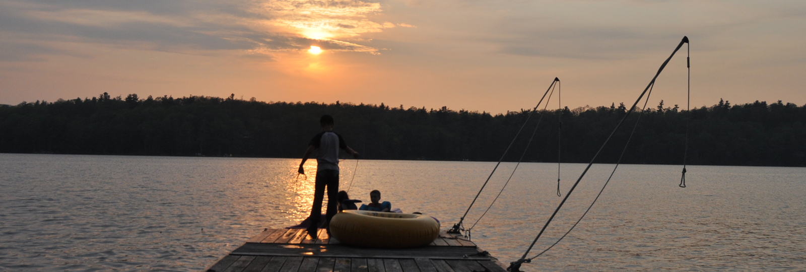 Kids on dock at sunset, Bob's Lake, Wesport