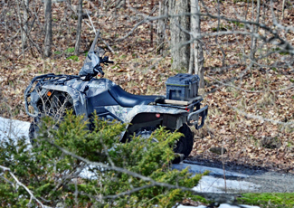 An All Terrain Vehicle in the woods