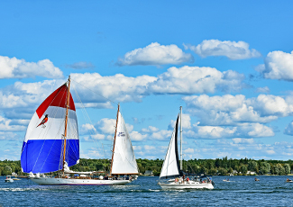Three Sail boats sailing on the St. Lawrence River