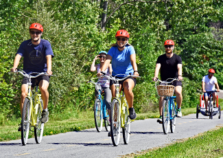 Cyclists riding their bikes along the Waterfront Trail