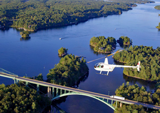 View of a helicopter flying over the 1000 Islands