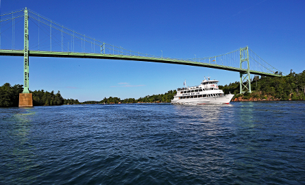 Cruise ship on the St. Lawrence River, going under 1000 Islands international bridge